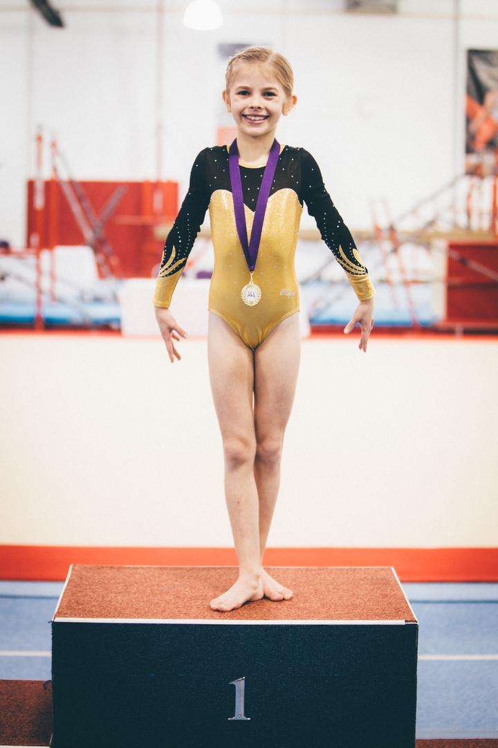 16527fd63394 Spectrum Gymnastics Academy - COMPETITIONS